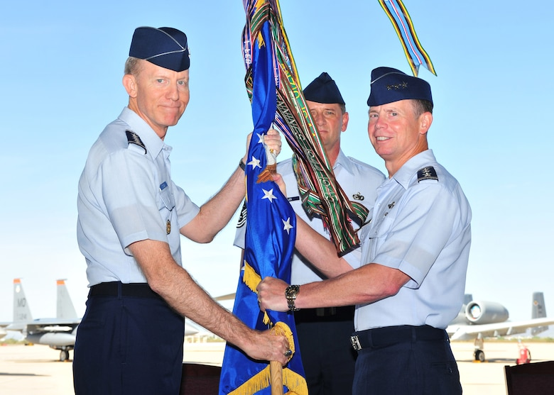 DAVIS-MONTHAN AFB, Ariz. -- Gen. John Corley, Air Combat Command commander (left), bestows the 12th Air Force (Air Forces Southern) guidon to Lt. Gen. Glenn Spears as he took command of the unit during a ceremony here Aug 7.  General Spears assumed command from Lt. Gen. Norman Seip.  (U.S. Air Force photo by Senior Airman Noah Johnson)