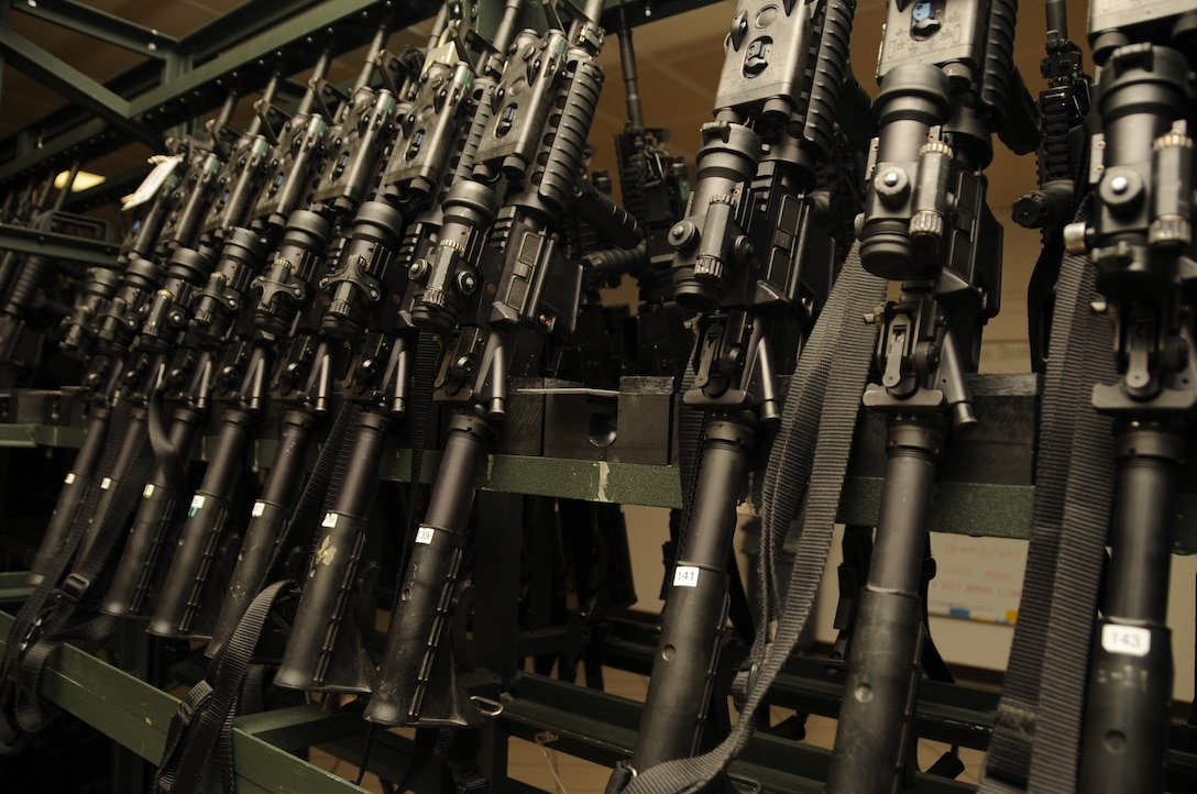 M4 Carbine assault rifles lined up in storage at the 28th Security Forces Squadron Armory, August 6.  The 28 SFS carries a variety of weapons such as the M4 carbine assault rifle, M-240B machine gun, M-870 shotgun and M-24 sniper rifle, just to name a few. (U.S. Air Force photo/Airman 1st Class Anthony Sanchelli)