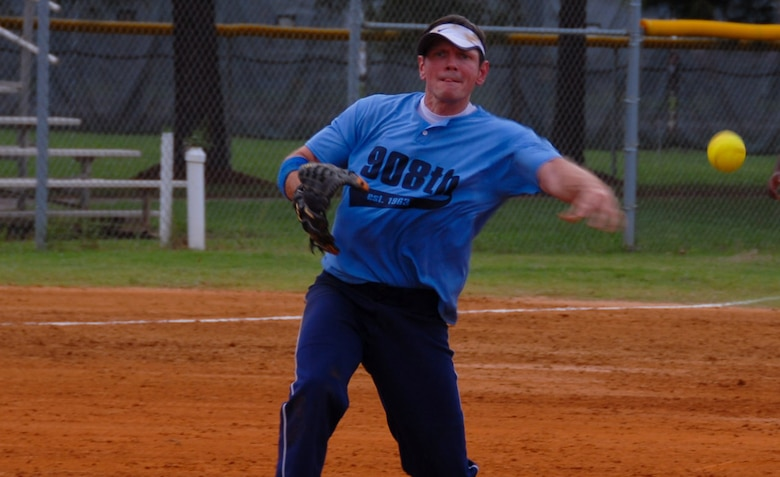 Master Sgt. Mark Naglic from the 908th Airlift Wing was the winning pitcher of both games during the Maxwell-Gunter intramural softball championship July 30. The 908th won the championship game against the Electronic Systems Group to capture the title. (U.S. Air Force photo/Jamie Pitcher)