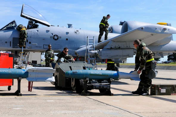 SPANGDAHLEM AIR BASE, Germany -- Members of the 81st Aircraft Maintenance Unit prepare an A-10 Thunderbolt II for a mission during the Phase II exercise Aug. 5. Members of the 52nd Fighter Wing were required to perform daily functions in a simulated chemical environment during the wing's Phase II exercise Aug. 4-7. (U.S. Air Force photo/Airman 1st Class Nathanael Callon)