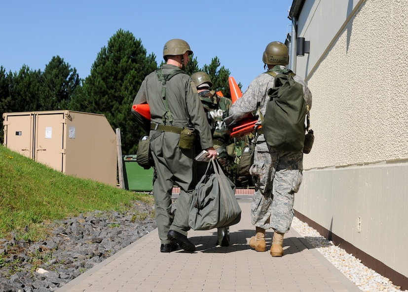 SPANGDAHLEM AIR BASE, Germany -- Members of the 81st Fighter Squadron perform a post attack reconnaissance sweep around the perimeter of a building during the Phase II exercise Aug. 4. The exercise tested the 52nd Fighter Wing's ability to operate under conventional, and chemical, biological, radiological or nuclear attacks. (U.S. Air Force photo/Airman 1st Class Nathanael Callon)