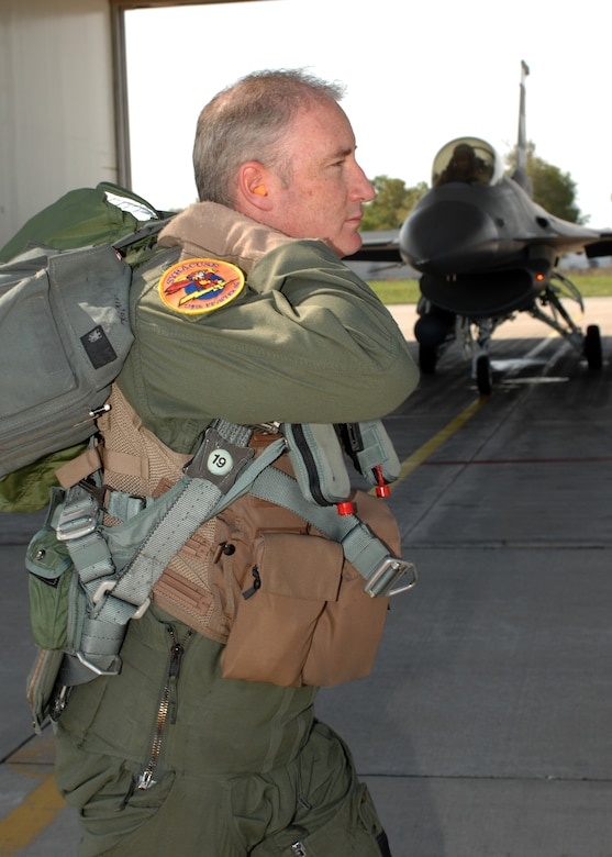 """Lt. Col. D. Scott Brenton a pilot assigned to the 174th Fighter Wing, Hancock Field, Syracuse, NY """"steps"""" to the F-16 Fighting Falcon that will carry him to the milestone achievement of more than 4,000 flying hours inside the cockpit."""