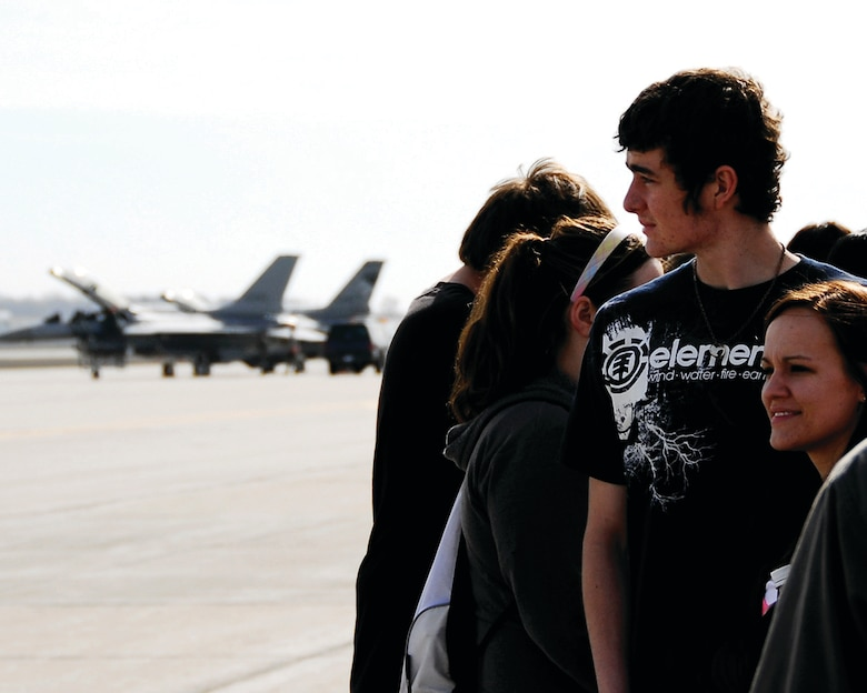 SIOUX FALLS, S.D. -- Taylor Wrighton and Sam Goossen, students at Marion High School, join other Career Day attendees to watch the launching of the F-16 aircraft at Joe Foss Field, SD.  Career Day is an annual event held by the 114th Fighter Wing recruiters to show interested high school students some of the many career opportunities available at the South Dakota Air National Guard.  This years Career Day was held on Apr. 15. (U.S. Air Force Photo by Master Sgt. Nancy Ausland)