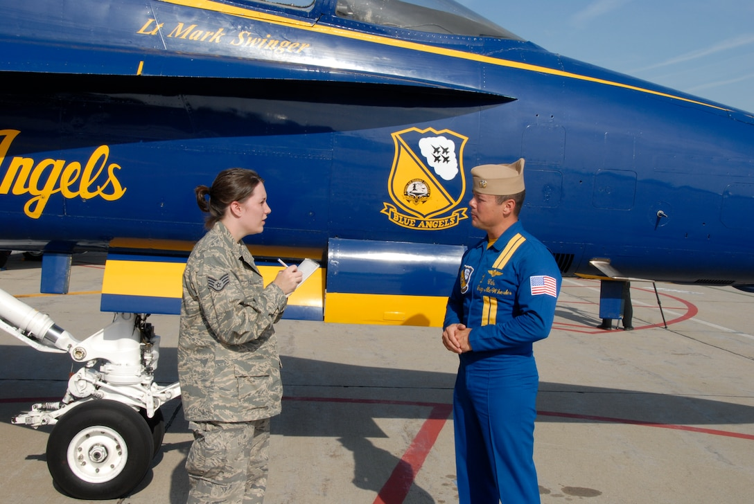 Staff Sgt. Miranda Skiles interviews Cmdr. Greg McWherter, flight leader and commanding officer of the Navy Blue Angels flight demonstration team. (U.S. Air Force Photo by Master Sgt Chris Stewart)