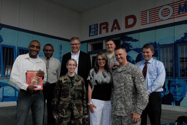 Master Sgt. Chris Stewart and Staff Sgt. Kristi Niedert, 114th Fighter Wing Public Affairs, pose with Maj. Brendan Murphy, S.D. State Public Affairs Officer and other members of the S.D. press  in front of Radio 10 in Paramaribo, Suriname July 1.