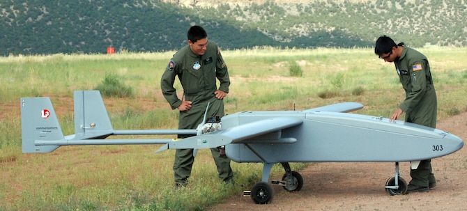 Air Force Cadets 2nd Class Jeffrey Nakayama and Rupert Domingo inspect a Viking 300 unmanned aerial vehicle before launch from Camp Red Devil at Fort Carson, Colo., July 20, 2009. The U.S. Air Force Academy's new Unmanned Aerial System training is designed to encourage cadets to serve as UAS leaders after graduation. The Viking 300 weighs between 200 and 300 pounds and has a top speed of 100 knots, with a cruising speed of 55 knots. (U.S. Air Force photo/Ann Patton)