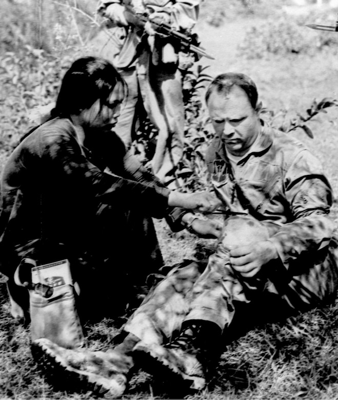 North Vietnamese propaganda photo of downed U.S. airman receiving first aid. (U.S. Air Force photo)