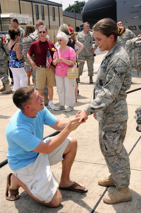 Brian Hickman proposes to his girlfriend, Senior Airman Gabriella Brewer, at Keesler Air Force Base, Miss., on Aug. 6, 2009. Airman Brewer, a 403rd Security Forces Squadron reservist, returned to Keesler the same day after a six-month deployment to Kirkuk Regional Air Base, Iraq. (U.S. Air Force photo/ Staff Sgt. Tanya King)