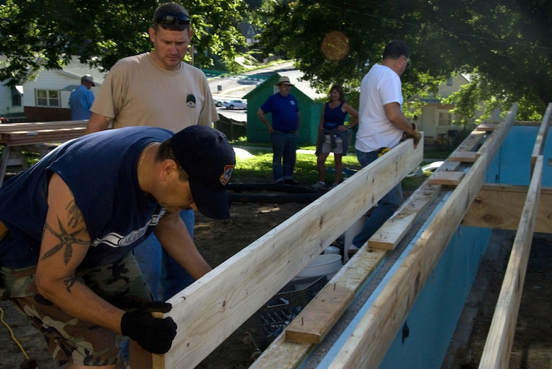 139th Airlift Wing members volunteer during a house construction project on July 18, for the Habitat for Humanity project in St. Joseph.  (U.S. Air Force photo by Master Sgt. Shannon Bond) (RELEASED)