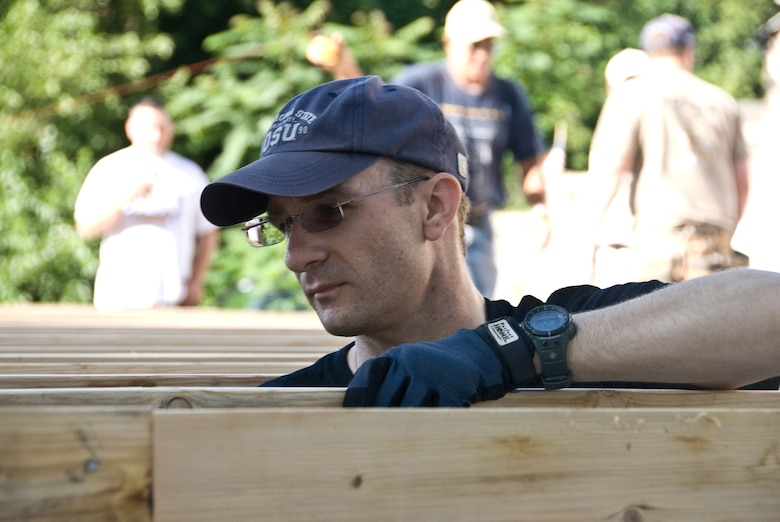 Master Sgt. Brian Jansen volunteers during a house construction project on July 18, for the Habitat for Humanity project in St. Joseph.  (U.S. Air Force photo by Master Sgt. Shannon Bond) (RELEASED)