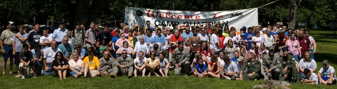 Campers, volunteers and National Guard members pose in front of a large Camp Guardian banner for a group photo during Mo. Adjutant General Stephen Danner's visit to the camp during the 2009 session.