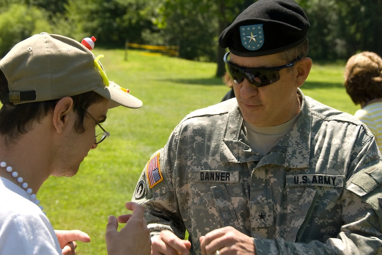 Brig. General Stephen Danner, Missouri Adjutant General, visits with campers at Camp Guardian during the 2009 session.