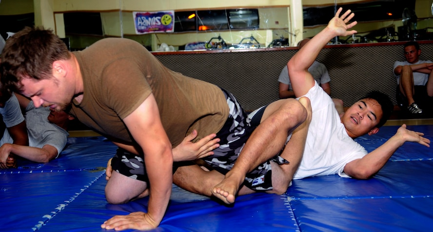 Staff Sgt. Michael Limiac, a 39th Medical Support Squadron medical information systems technician, releases John Pope, husband of Staff Sgt. Lisa Pope, a 39th Air Base Wing Anti-Terrorism Force Protection specialist, after he taps out due to a heel hook during a mixed martial arts training session Friday, Aug. 7, 2009 in the Fitness Center at Incirlik Air Base, Turkey.  Sergeant Limiac coordinates the workout sessions three times per week.  Participants of all skill levels attend the workouts and train to build on their knowledge of the sport.   More than 20 Airmen have attended the workouts since implementation.  (U.S. Air Force photo/Staff Sgt. Raymond Hoy)