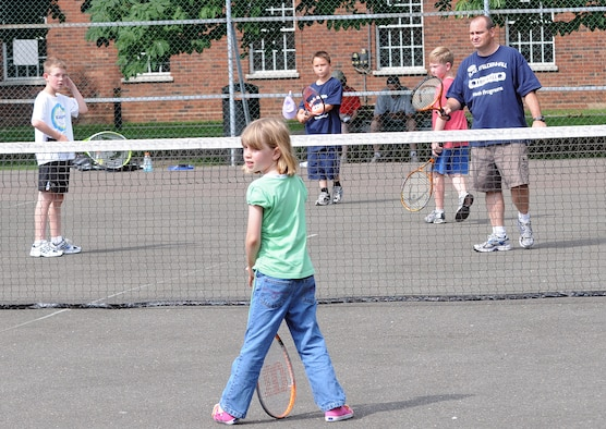 RAF MILDENHALL, England -- David Wilcox (far right), Mildenhall Youth Programs youth services coordinator, hosted a tennis camp for eight kids Aug. 6 at the Middleton Hall tennis courts. This was the second of two tennis camps this year. Youth Programs, operated through the youth center, is also hosting a volleyball clinic Aug. 17 to 18 from noon to 2 p.m. To register, call DSN 238-2831. (U.S. Air Force photo by Senior Airman Thomas Trower)
