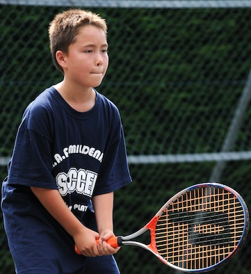 RAF MILDENHALL, England -- Keanu McElroy awaits a serve from the opposing team during a game of Elimination Aug. 6 at the Middleton Hall tennis courts. Keanu was one of eight kids participating in the Mildenhall Youth Programs camp, the second of two this summer. A volleyball camp is being offered by Mildenhall Youth Programs from Aug. 17 to 18 from noon to 2 p.m. To register, call DSN 238-2831. (U.S. Air Force photo by Senior Airman Thomas Trower)