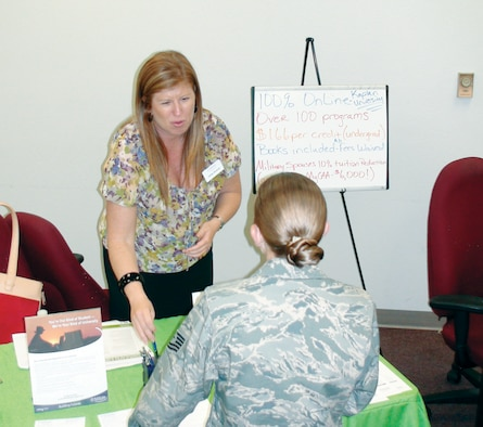 Hether Buckner (left), Education Liaison for Kaplan University, discusses Registered Nursing degree programs with Tech. Sgt. Kelly Buettner at the annual Education Fair. Approximately 50 people attended this event which followed the Community College of the Air Force graduation ceremony at March Air Reserve Base. (U.S. Air Force photo/ Master Sgt Mike Blair)