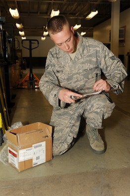 Senior Airman David Bennett, 19th Logistics Readiness Squadron, creates a serviceable tag for a part at Little Rock Air Force Base, Ark. May 8. (U. S. Air Force photo by Senior Airman Jim Araos)
