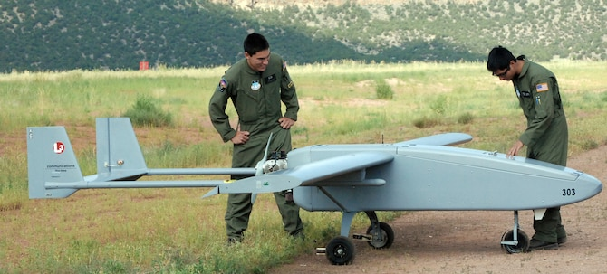 U.S. Air Force Academy Cadets 2nd Class Jeffrey Nakayama and Rupert Domingo inspect a Viking 300 unmanned aircraft vehicle before launch from Camp Red Devil July 20 at Fort Carson, Colo. The Academy's new UAS training is designed to encourage cadets to serve as UAS leaders after graduation. The Viking 300 weighs between 200 and 300 pounds and has a top speed of 100 knots, with a cruising speed of 55 knots. (U.S. Air Force photo/Ann Patton)