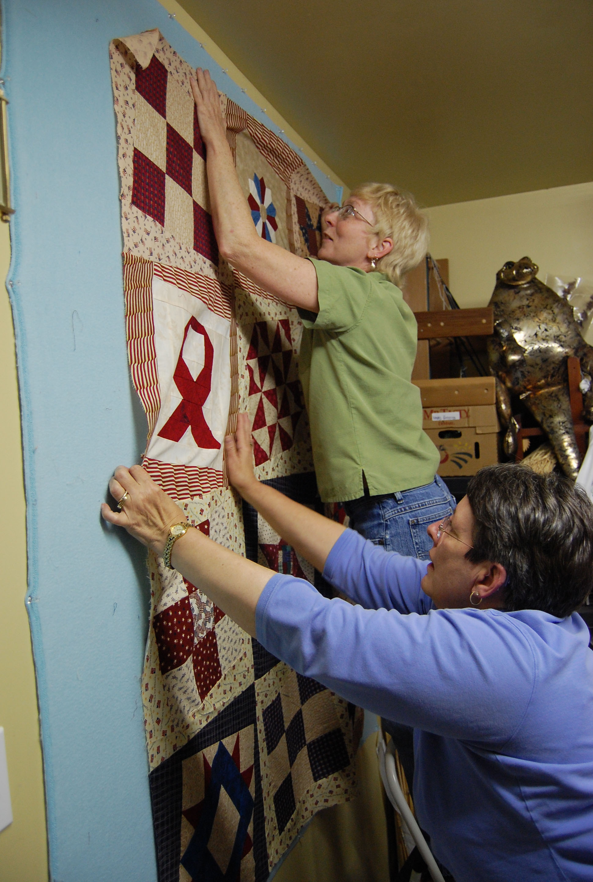 6e3a5f990d Quilters from Seaford, Delaware spread out a Quilt of Valor quilt ...