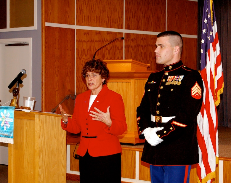 U.S. Marine Staff Sgt. Crowley is awarded a Quilt of Valor from Catherine Roberts, the founder of the Quilts of Valor Foundation, at the Nanticoke Rotary Club in Seaford, Del., Nov. 29, 2006. (Photo courtesy of Catherine C. Roberts, Quilts of Valor Foundation)
