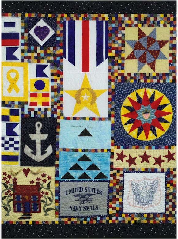 This Quilt of Valor was created over a nine-month period by quilt topper Helen Ruiz of Dover, Del., to award to a U.S. Navy Seal to give him comfort in his recovery from war wounds. (Courtesy photo/Ms. Helen Ruiz)