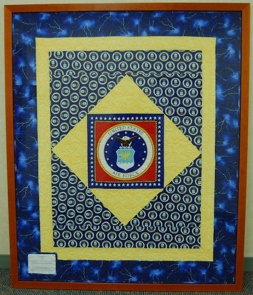Quilters from Valdosta and Norcross, Ga., made this Quilt of Valor in 2009 for the Air Force Mortuary Affairs Operations Center located at Dover A.F.B., Del. The framed quilt is on the wall of the center's main hallway (U.S. Air Force photo/Master Sgt. Robert Jones)
