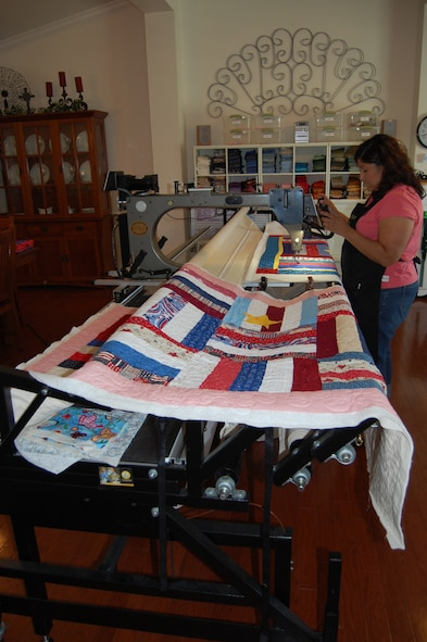 Irene Hafer of Dover, Delaware, works on a Quilts of Valor quilt on her longarm machine in her home studio June 24, 2009. (U.S. Air Force photo/Tech. Sgt. Benjamin Matwey)