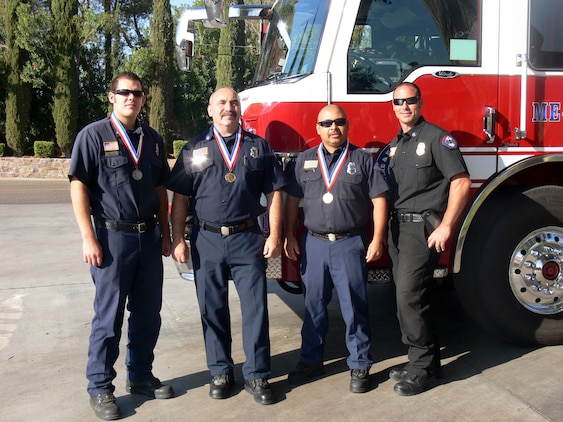 Marine Corps Logistics Base Barstow firefighters (left to right) Shaun Longlee, Dell Warfield, Ruben Rodriguez and Assistant Chief Paul Purdy, proudly display medals won at the 2009 California Firefighter Olympics. The firemen competed in the annual California Firefighter Olympics, a statewide competition held in Anaheim, Calif., that promotes camaraderie and sportsmanship amongst the fire departments.
