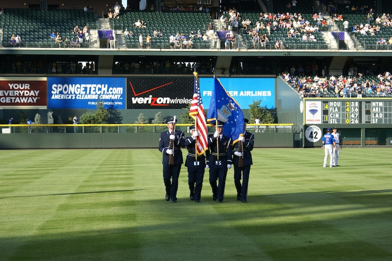 DENVER -- Presenting the colors Aug. 10 at a Rockies vs. Cubs game at Coors Field in Denver are (in no particular order) Tech. Sgt. Edward Wise, Staff Sgt. Joshua Petersen and Airmen 1st Class Kevin Scott and Samuel Wenrich, members of the Mile High Honor Guard at Buckley Air Force Base, Colo. The Mile High Honor Guard is composed of volunteers from many different career fields across Buckley. (U.S. Air Force photo)