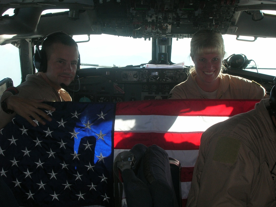 Capt. Kristen Thompson, pilot, 964th Expeditionary Airborne Air Control Squadron, and her deployed crew fly an American flag over the skies of Southwest Asia in Chief Foltz's honor. Photo courtesy of Captain Thompson.