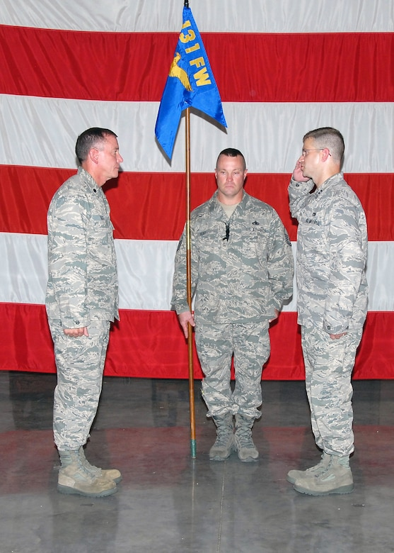 """""""Sir, I assume command!"""" Capt. Mark Risley, incoming 131st Maintenance Operations Flight commander, salutes Lt. Col. Mark Beck, 131st Maintenance Group commander, during the Assumption of Commands ceremony held at the Army National Guard Armory,  Whiteman Air Force Base, Mo., Aug 8.  (U.S. Air Force Photo by Master Sgt. Mary-Dale Amison)"""