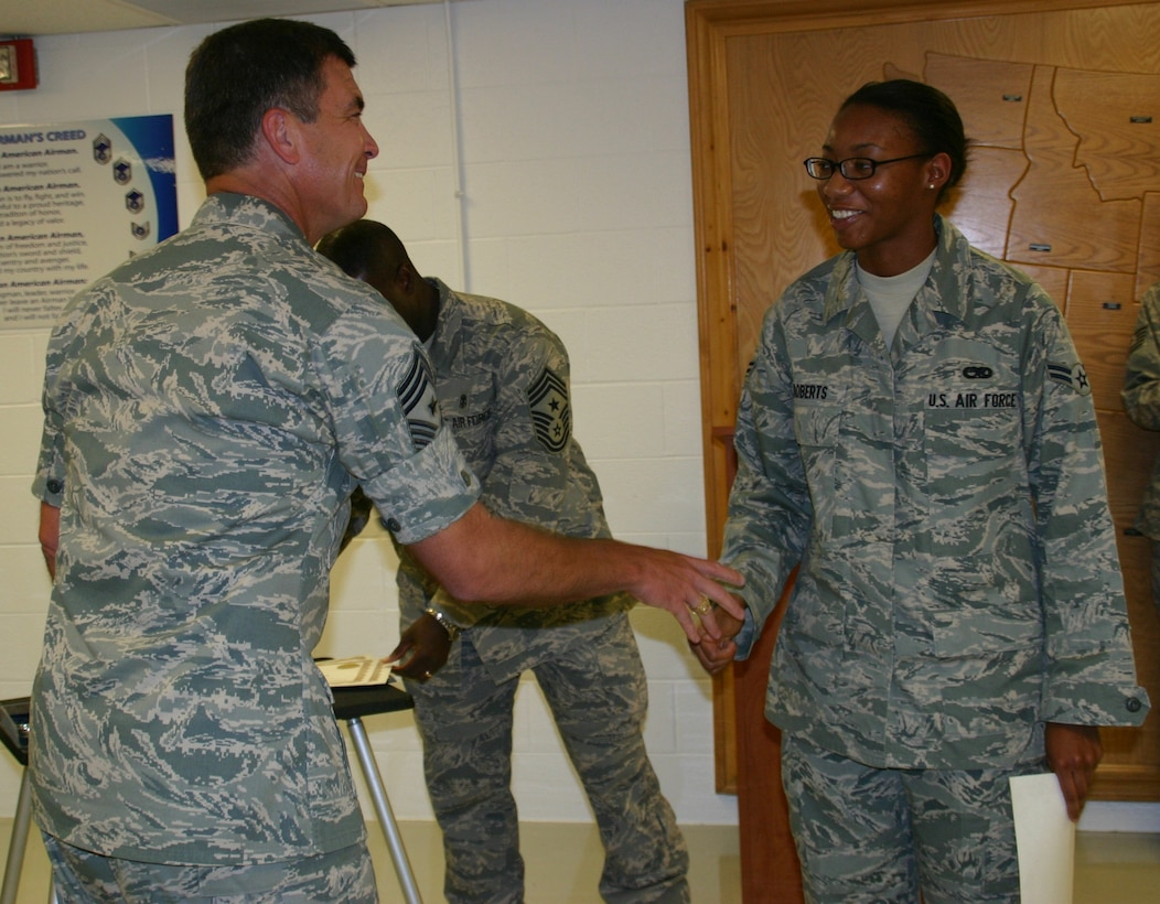 Chief Master Sgt. James Foltz, former command chief, 552 ACW, congratulates one of the latest graduates at the First Term Airman Center. Photo courtesy of 1st Lt. Kinder Blacke.