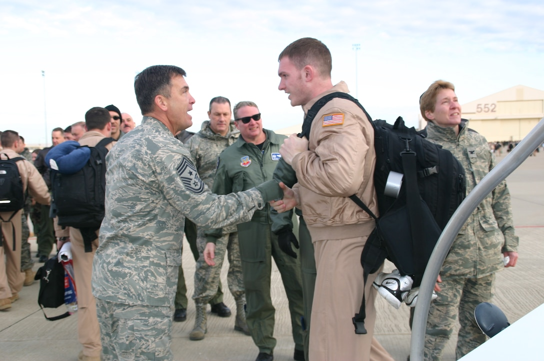 Chief Master Sgt. James Foltz welcomes one of his Airmen home after a deployment. Greeting crews as they return is one of Chief Foltz's most cherished experiences as the former command chief of the 552 ACW. Photo courtesy of 1st Lt. Kinder Blacke.