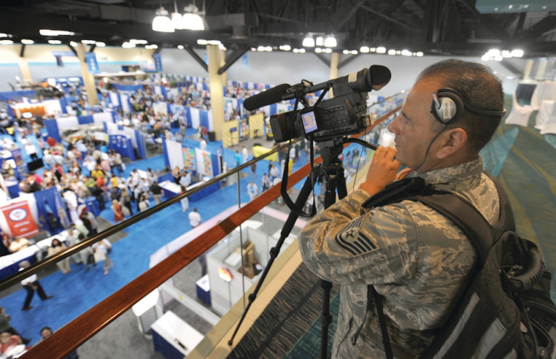 U.S. Air Force Tech. Sgt. Henry Guardado, a videographer with the 4th Combat Camera Squadron, documents the activities during the 2009 LULAC Convention. LULAC is the nation's oldest and largest Hispanic organization and has been advocating for Latinos in the United States for 80 years. (U.S. Air Force photo by Tech. Sgt. Efren Lopez)