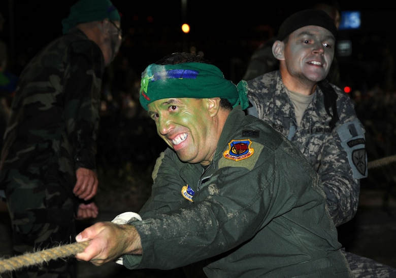 Col.  Carl Frushon, GPS Wing vice commander, and Capt. Ryan Burris put their muscle into the tug of war competition during the SMC Combat Dining In, Aug. 7.  (Photo by Lou Hernandez)
