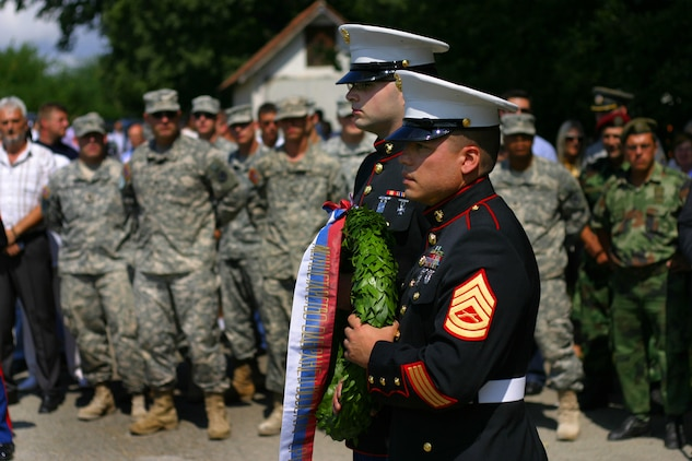 Marine Security Guards for the U.S. Embassy in Belgrade, Serbia Lance  Aaron Johnston and Gunnery Sgt. Laureano Perez lay a wreath at the Halyard Mission memorial in Pranjanje, Serbia, Aug 15, 2009 during the 65th annivesary of the Halyard mission.