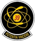 "The patch consists of a red ""39"" within the nucleus of a yellow atom. The atom is set on a dark blue circle, ringed by a silver border. At the bottom is the squadron motto, ""Potentia Vincere"", which is Latin for ""The power to conquer"". The atom represents the unlimited abilities in each squadron member, and the unity of the squadron as a whole. The colors represent the four classes, and the unified design represents the cooperation necessary among the classes to insure an effective squadron. This was the squadron's original patch, which was discontinued in 1980, but revived in 1991."