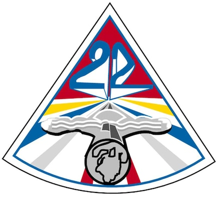 "The patch is a triangle with a three-dimensional ""22"" in the upper part of its red field. A saber with navigator wings on its center and globe on the end of its hilt points toward the center of the field. Eight red, gold, blue and silver rays emanate from the center of the patch.