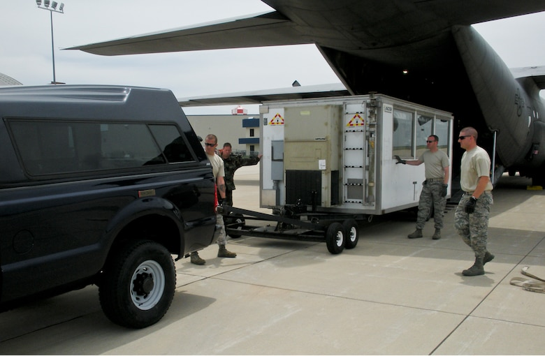 Members of Kentucky Air Guard's 123rd Contingency Response Group off-load a mobile command post as part of Operation Ardent Sentry.