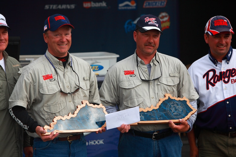 Col Tim Dearing and Master Sgt. Bo Sales proudly display their winner plaques for First Place at the National Guard fishing tournament in Kentucky.  (Photo by Jason Sealock)