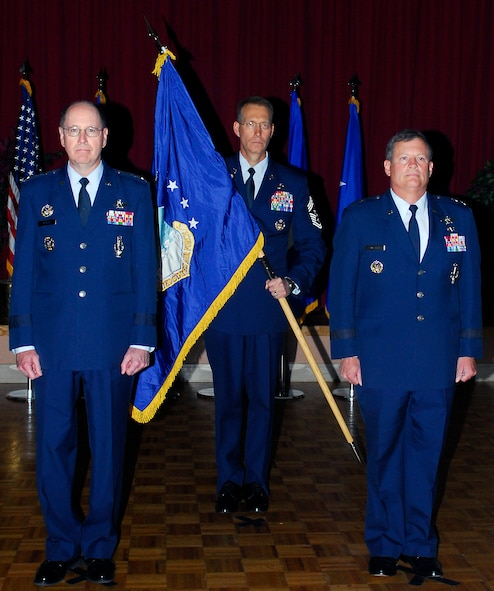 From l-r:  Gen. C. Robert Kehler, commander Air Force Space Command, Chief Master Sgt. Todd Small, AFSPC command chief, and Maj. Gen. Richard Webber, stand at attention during the 24th activation ceremony held at Lackland AFB, TX. General Kehler presided over the ceremony to activate the NAF, handing the command to General Webber, as the first commander of the 24 AF dedicated to cyberspace.  The 24th Air Force activation under Air Force Space Command is a major milestone in the combination of space and cyberspace operations within one command. General Kehler presided over the ceremony to activate the new numbered Air Force.  (Courtesy photo)
