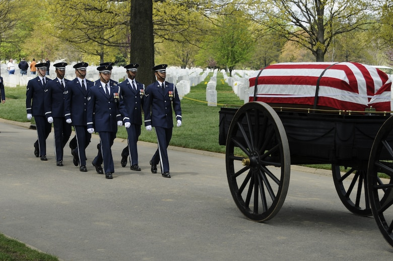 A United States Air Force Honor Guard body bearer team marches behind a caisson during a full honors funeral ceremony at Arlington National Cemetery. Honor guard body bearers train constantly to maintain the precision they are known for. Their standards of flawlessness are set out of necessity to honor fallen Airmen. (U.S. Air Force photo by Staff Sgt. Daniel DeCook)