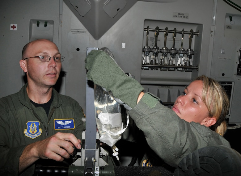 Capt. Matt Grimes and 2nd Lt. Amanda Piersak, flight nurses in the 934th Aeromedical Evacuation Squadron, set up an intravenous drip aboard a C-17 aircraft during dissimilar aircraft readiness training Aug. 8, 2009. The squadron hosted the training at Minneapolis-St. Paul International Airport Air Reserve Station, Minn., Aug. 8-9. (U.S. Air Force photo/Tech. Sgt. Jeffrey Williams)