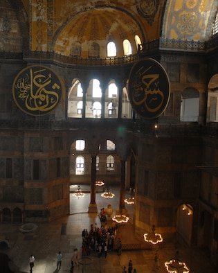 Two large medallions hang from the walls at the Aya Sofya in Istanbul Turkey. The medallions were crafted by master calligrapher Mastafa Izzet Efendi. The Aya Sofya or as it is called in English, the Church of the Divine Wisdom, was completed in 537 AD by Roman Emperor Justinian as a church and then was converted to a mosque in 1453 by Mehmet the Conqueror.  In 1935 Ataturk proclaimed the mosque a museum.  (U.S. Air Force photo/Staff Sgt. Lauren Padden)