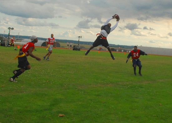 SPANGDAHLEM AIR BASE, Germany -- Maurice Hardy, 52nd Communications Squadron, catches the ball during a pre-season flag-football game Aug 4. The Comm. Squadron played against the Civil Engineering Squadron during a pre-season tournament held on the field behind the fitness center. The flag football regular season began Aug. 24 and runs until Oct. 14. (U.S. Air Force photo/Airman 1st Class Nick Wilson)