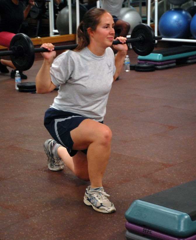 1st Lt. Melissa Croy does lunges using a Body Pump barbell Aug. 17, 2009 at the Harris Fitness Center. Instructing Body Pump classes is one of Lieutenant Croy's many extra curricular activities which garnered her the 2010 FSS CGO of the year award for ACC. (Photo by Airman 1st Class Sandy Healy)
