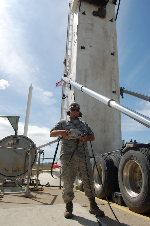 Senior Airman Derek Baker, 341st Missile Maintenance Squadron missile handling team technician, uses a hand-held controller to lower the 341st Missile Wing's 150th Minuteman III solid-propellant replacement booster into launch facility Echo-08 Aug. 18. The Propulsion Replacement Program, or PRP, extends the service life of the missile through 2020. The first MMIII replacement booster was delivered in April 2001.  (U.S. Air Force photo/Staff Sgt. Eydie Sakura)