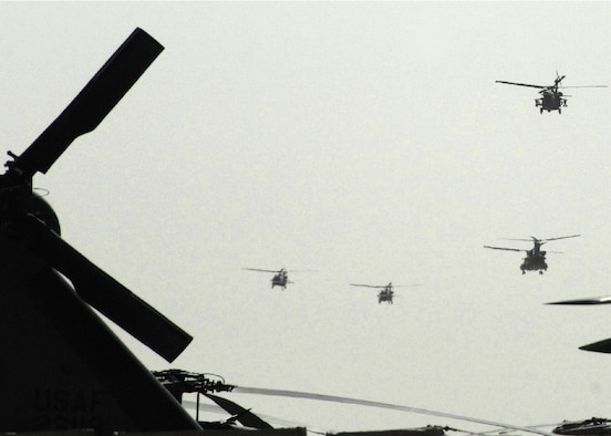 A formation of helicopters departs Kandahar Air Field, Afghanistan, to complete a rescue mission. (U.S. Air Force photo/Senior Airman Timothy Taylor)