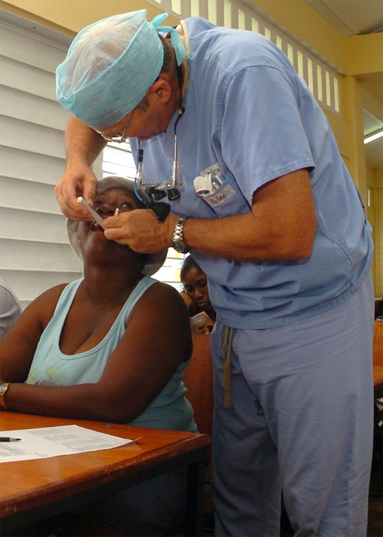 Lt. Col. (Dr.) Darryl Bybee performs a triage exam on a Guyanese women Aug. 18 in Georgetown, Guyana. This exam allows the dental staff to determine what the patients most urgent dental care needs are. Colonel Bybee is a member of the 75th Dental Squadron and is deployed here in support of New Horizons Guyana 2009, a joint humanitarian mission designed to strengthen the ties between the United States and Guyana. (U.S. Air Force photo by Staff Sgt. Jason Burton)