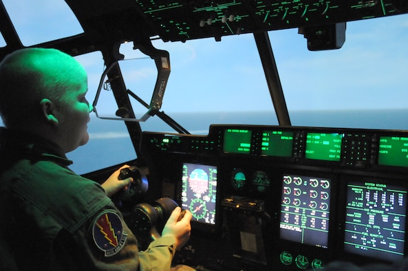Thirteen-year-old Sean Peneguy of Bay St. Louis takes the controls of a C-130J simulator in Lott Hall Friday during a Keesler visit arranged by the 45th Airlift Squadron and the Make-A-Wish Foundation.  (U.S. Air Force photo by Kemberly Groue)